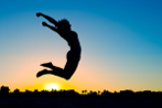 iStock_26397476_LARGE Woman Silhouette Jumping 147  pixels wide.png
